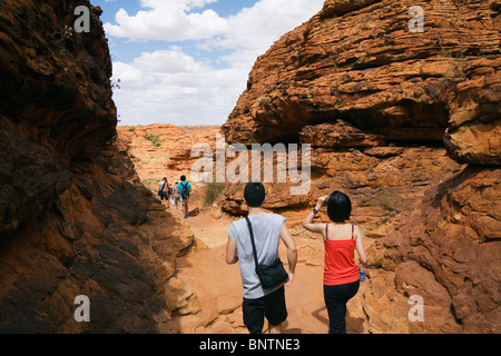 Tourists on the Kings Canyon walk. Watarrka (Kings Canyon) National Park, Northern Territory, AUSTRALIA. - Stock Photo