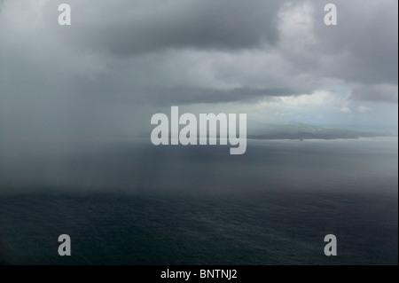 aerial view above rain shower Pacific ocean Nicaragua coastline - Stock Photo