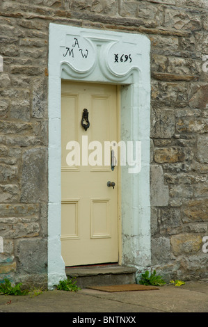 Door with datestone in the village of Gayle, Wensleydale, Yorkshire Dales National Park, north Yorkshire, England - Stock Photo