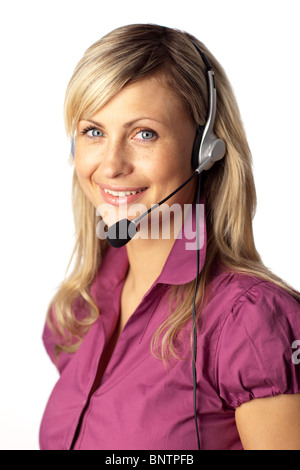 Young business woman talking on a headset - Stock Photo