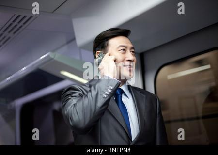 Businessman on the subway - Stock Photo