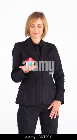 Mature woman working as a real state agent - Stock Photo