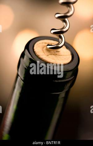 Opening a bottle of wine in celebration - Stock Photo