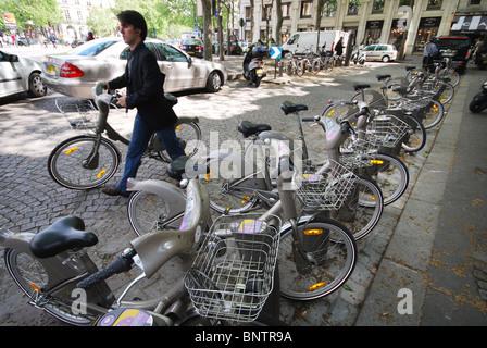 Velib bicycles for hire near l'Opera Paris France - Stock Photo