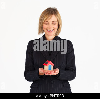 Mature woman dreaming of new house - Stock Photo