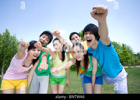 Portrait of a group of friends at the park - Stock Photo