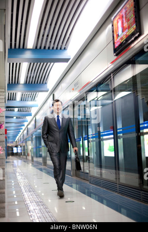 Commuter waiting for the subway train - Stock Photo