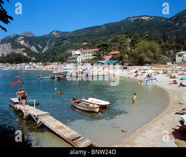 Popular beach at the west coast resort of Paleokastritsa - Stock Photo