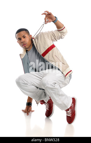 Young African American hip hop dancer performing isolated over white background - Stock Photo