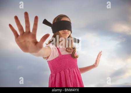 Blindfolded teenage girl - Stock Photo