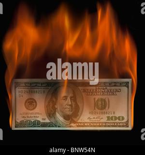 Burning 100 dollar bill - Stock Photo