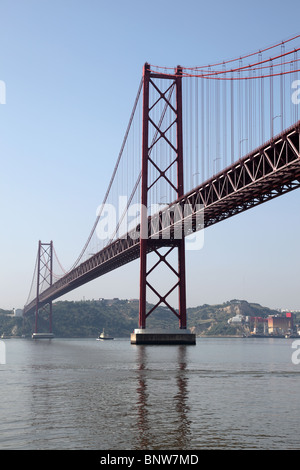 The 25 de Abril Bridge - suspension bridge over the river Tejo in Lisbon, Portugal - Stock Photo
