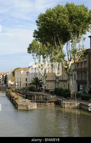 Lock gates on the Canal de la Robine in the centre of Narbonne South of France - Stock Photo