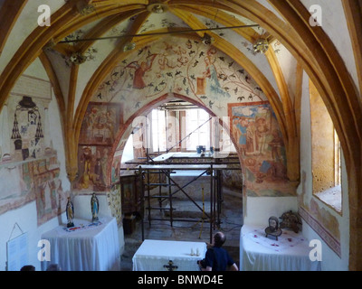 SLOVENIA - Bohinj. Medieval wall paintings being restored in the Church of St John the Baptist. Photo Tony Gale - Stock Photo