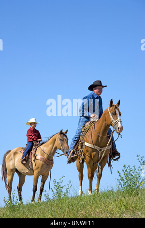 Riders waiting for a cattle drive bringing steers to the Cheyenne Frontier Days rodeo. - Stock Photo