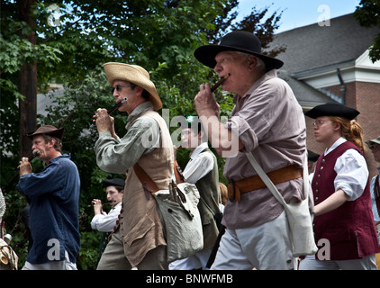 American Colonial fife and drum band in a 4th of July parade - Stock Photo