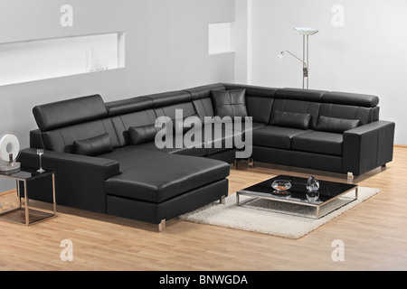 A view of a modern apartment with black leather sofa - Stock Photo