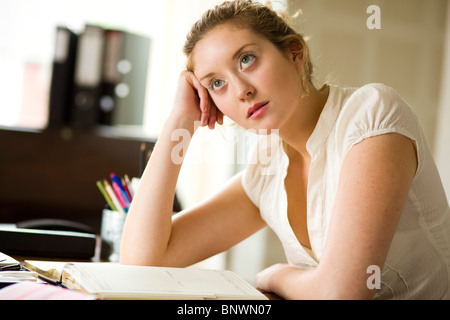 Woman in office bored - Stock Photo