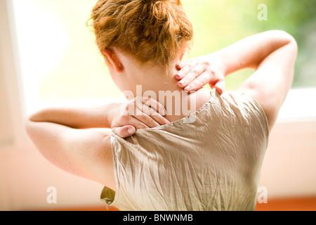 Woman with neckache - Stock Photo