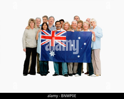 group of people holding an Australian flag - Stock Photo