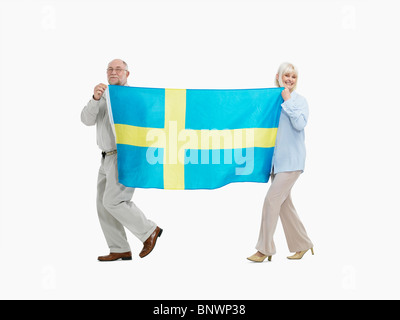 two people carrying the flag the Swedish flag