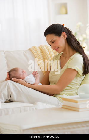 Mother sitting on couch with her baby