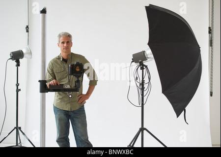 Professional photographer in his studio - Stock Photo