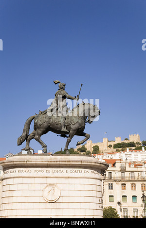 The statue of King Dom Joao I stands in front of the Castle of St George (Castelo de Sao Jorge) in Baixa, Lisbon, - Stock Photo