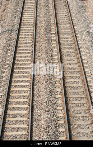 Looking down onto empty railway track in England - Stock Photo