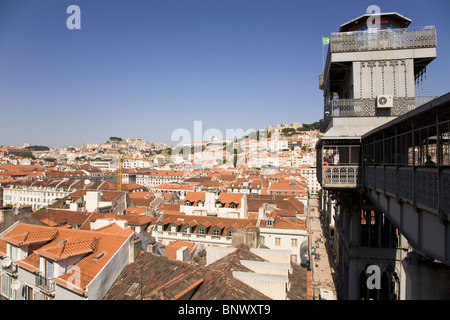The tiled roofs of the Baixa District run towards the Castle of St George under the Elevador Santa Justa in Lisbon, - Stock Photo