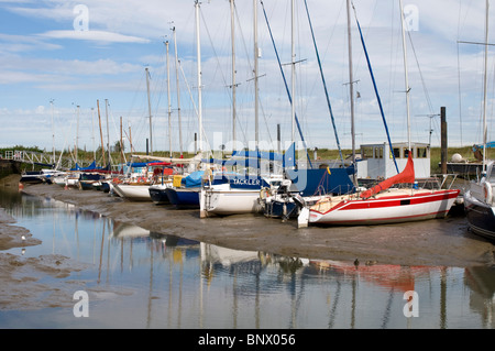 boats on the mud at low tide in swale marina conyer creek - Stock Photo