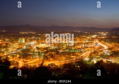 City skyline of Asheville, North Carolina, nestled in Blue Ridge Mountains - Stock Photo