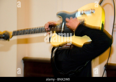 Lee Wharton of After Hours Blues Band playing the guitar behind his head during the Dundee Blues Bonanza 2010,UK - Stock Photo