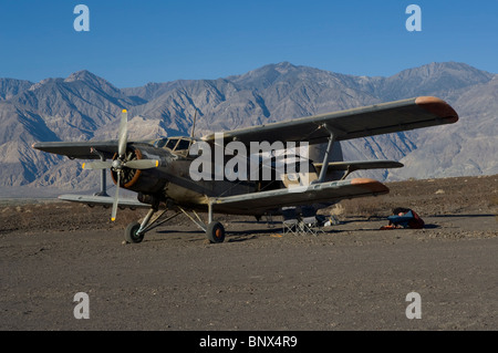 Antonov AN-2 biplane parked at Chicken Strip Saline Valley Death Valley National Park California near hot springs - Stock Photo