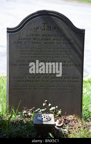Gravestone for family where two sons drowned at sea Laugharne Wales UK - Stock Photo