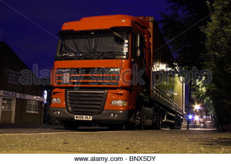 Lorry parked overnight with long distance driver sleeping in the vehicle cab on an industrial estate in Perivale, - Stock Photo