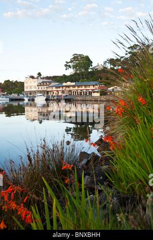 Dawn at the harbour township of Strahan on Tasmania's west coast. Strahan, Tasmania, AUSTRALIA - Stock Photo