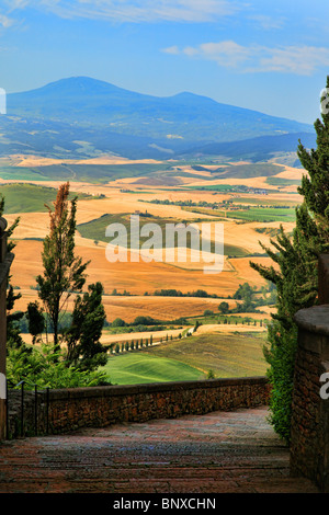 Walkway in Pienza provides stunning views of the surrounding Tuscan landscape - Stock Photo