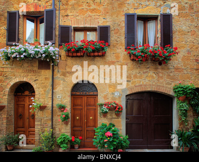 House fronts in the Tuscan hill town of Pienza, Italy - Stock Photo