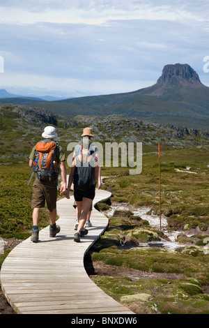 Hikers on the Overland Track on the Cradle Plateau.  Cradle Mountain-Lake St Clair National Park, Tasmania, AUSTRALIA - Stock Photo