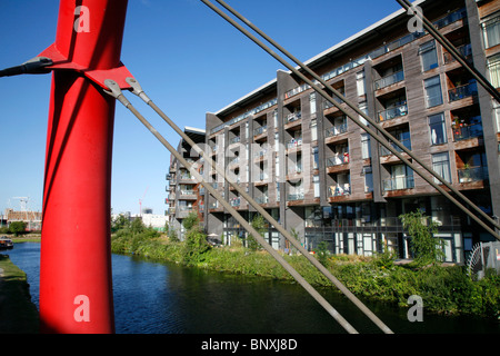 Omega Works apartment block by the side of the Hertford Union Canal on Fish Island, Hackney Wick, London, UK - Stock Photo