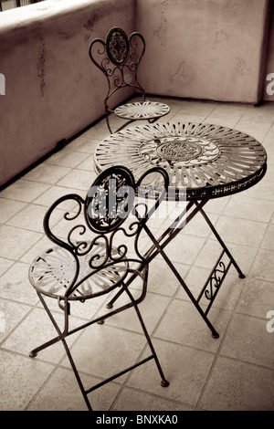 Vintage Antique Iron Table and Chairs - Stock Photo
