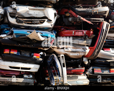 Piled up crushed cars on a scrap yard - Stock Photo