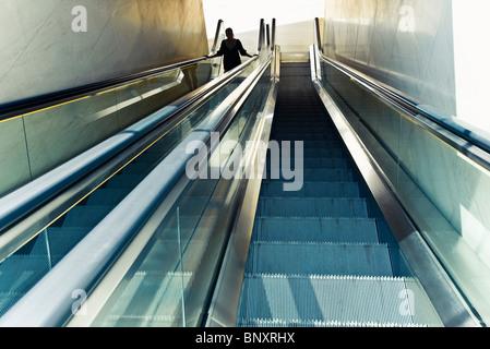 Riding escalator - Stock Photo