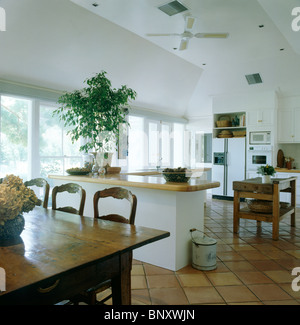 Large open plan kitchen and dining room with lighted false ceiling ...