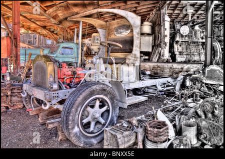 Old Truck in Auto Shop one half Colored and one half Black and White - Stock Photo