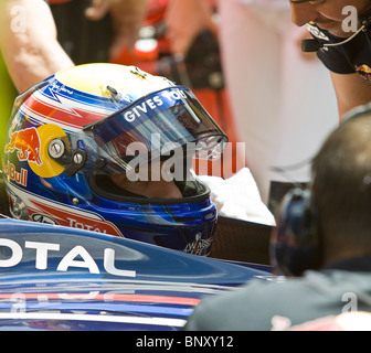 Mark Webber F1 head shot helmet in car - Stock Photo