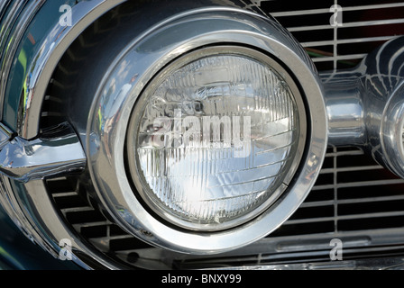 Round headlight on a Oldsmobile Super 88, classic car. - Stock Photo