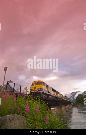 Alaska Railroad train riding along the tracks in Alaska - Stock Photo