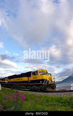 Alaska Railroad train riding along Turnagain Arm in Alaska - Stock Photo